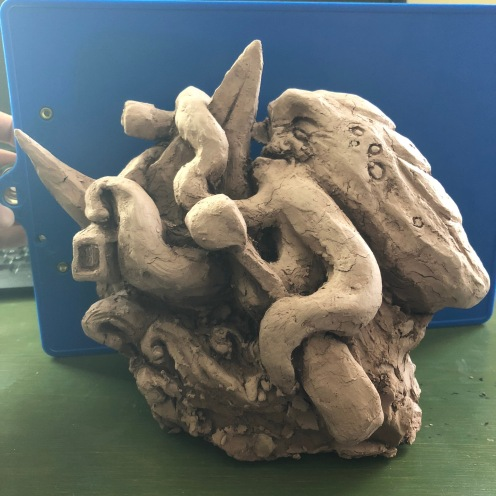 We worked on clay models to practice making our cuts from a block. The clay models were later used as display for viewers to see our design before completion.